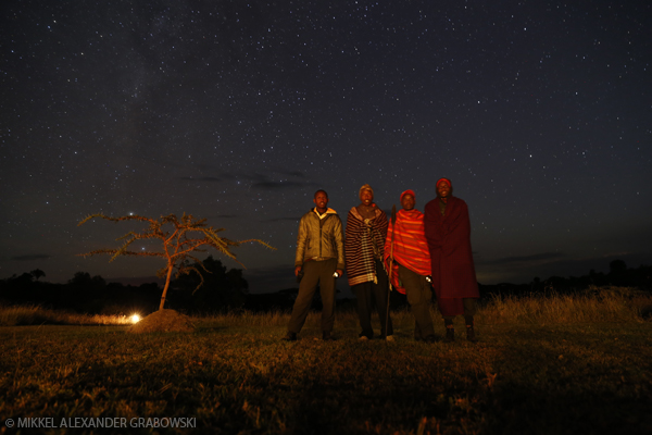 Masai Askaris at a camp under the Milky Way