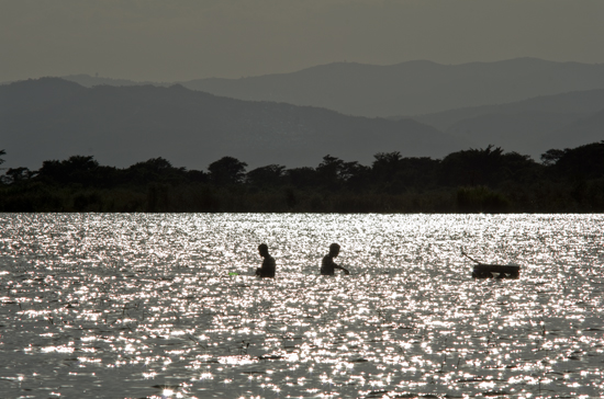 Fishermen and lake and mountains in Ethiopia