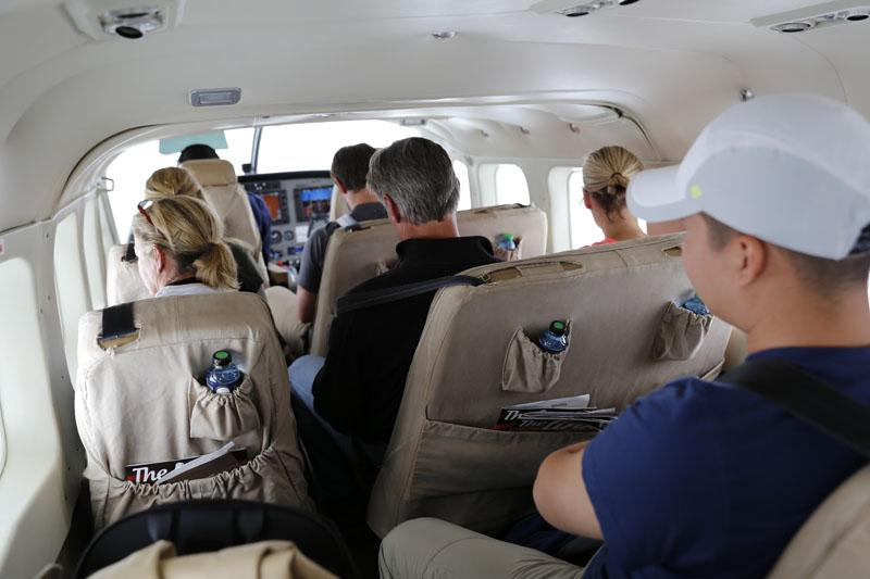 People in a small aeroplane on the way to Masai Mara