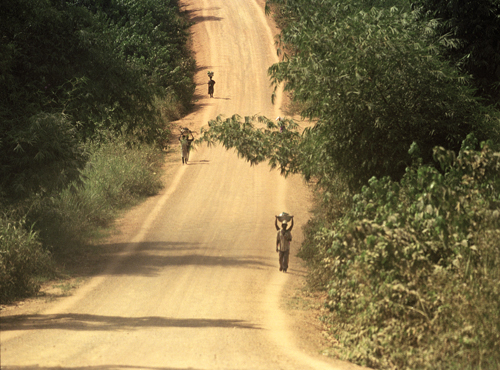 road in africa with people walking