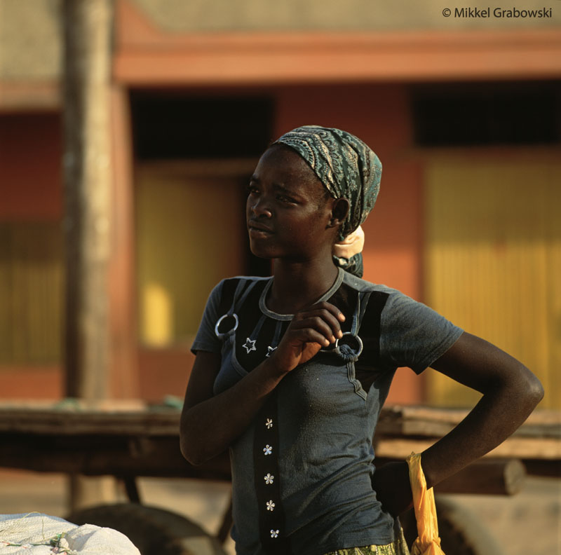 A woman at the market in jinka watches as the vendors pass by. Photo © Mikkel Grabowski 2012