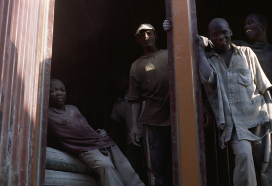 Workers in Kisumu taking a break from loading a truck with heavy bags of cement - photo © Mikkel Grabowski 2004