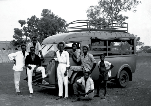 The people, their clothing and the automobile shows a past time in Africa. Photograph © by Soungalo Male, 1960