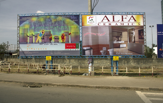 Huge billboards with photograps and graphic art surrounds the stadion in Addis Ababa. Also in Awasa and many other towns in Ethiopia the use of big billboards at roadsides and roundabouts have become common sights. Photo: Mikkel Grabowski 2012