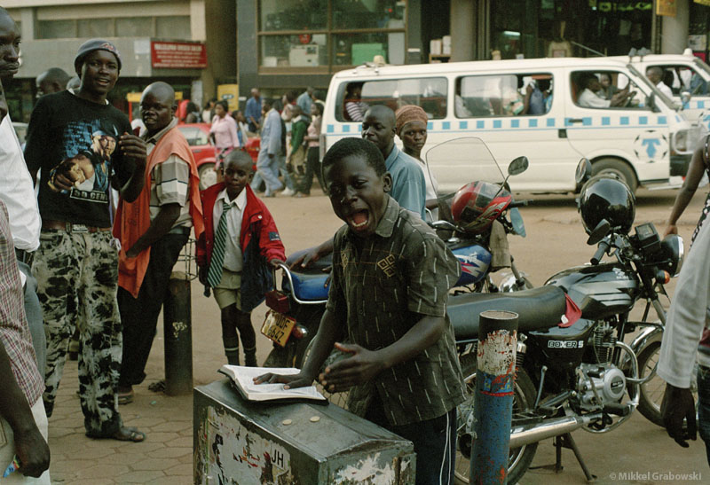 Boy preaching in the street of kampala - photo © Mikkel Grabowski