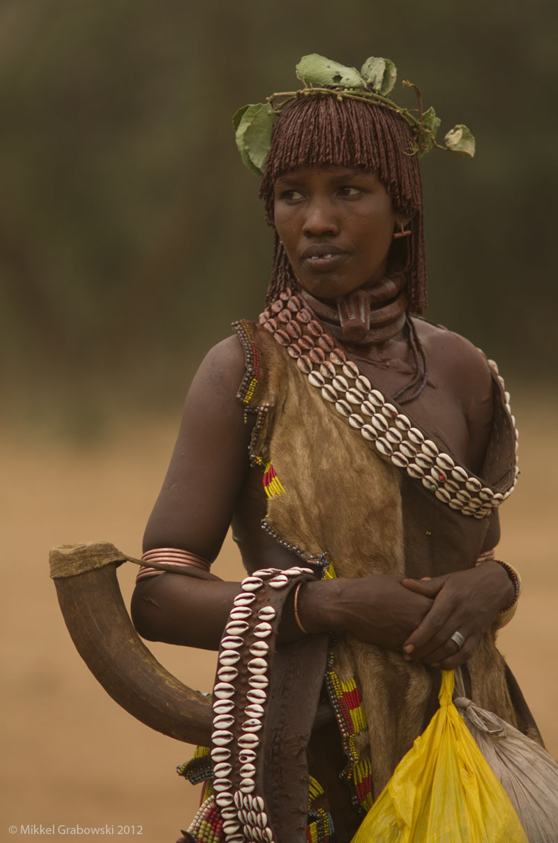 A Hamer woman decorated with leaves in her hair