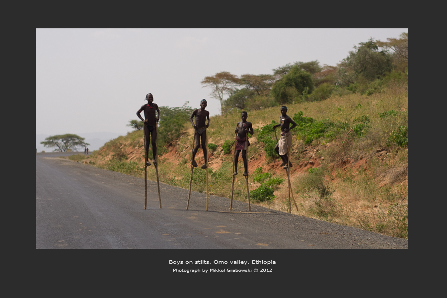 boys on stilts in Omo valley photo © mikkel grabowski