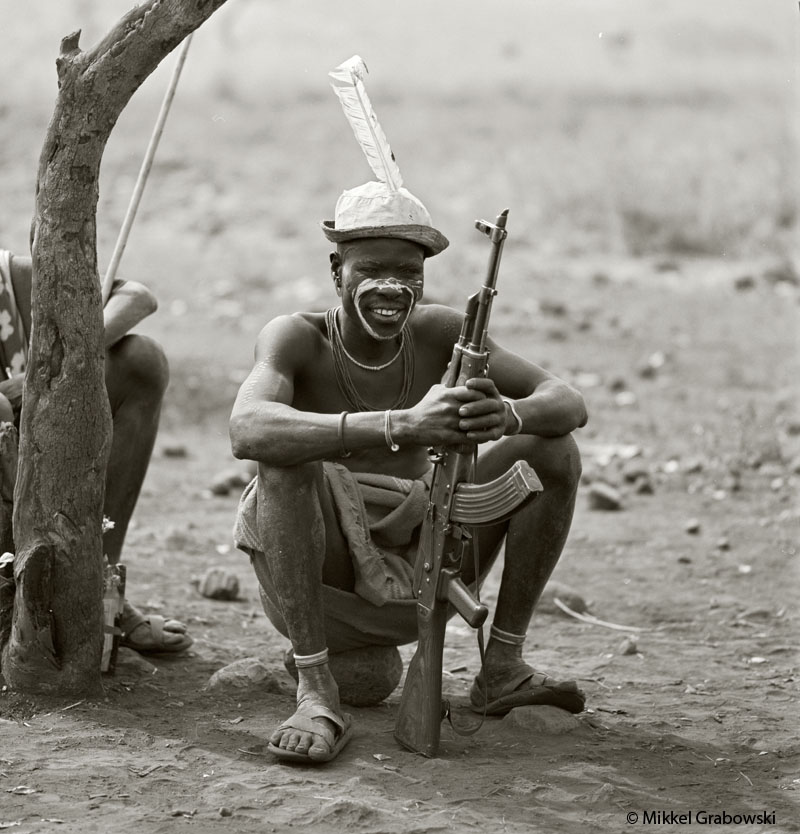 A man from the Mursi tribe with his gun. Violent clashes and rivalry between the tribes and clans over cattle are not uncommon in Omo valley - photo © Mikkel Grabowski 2012
