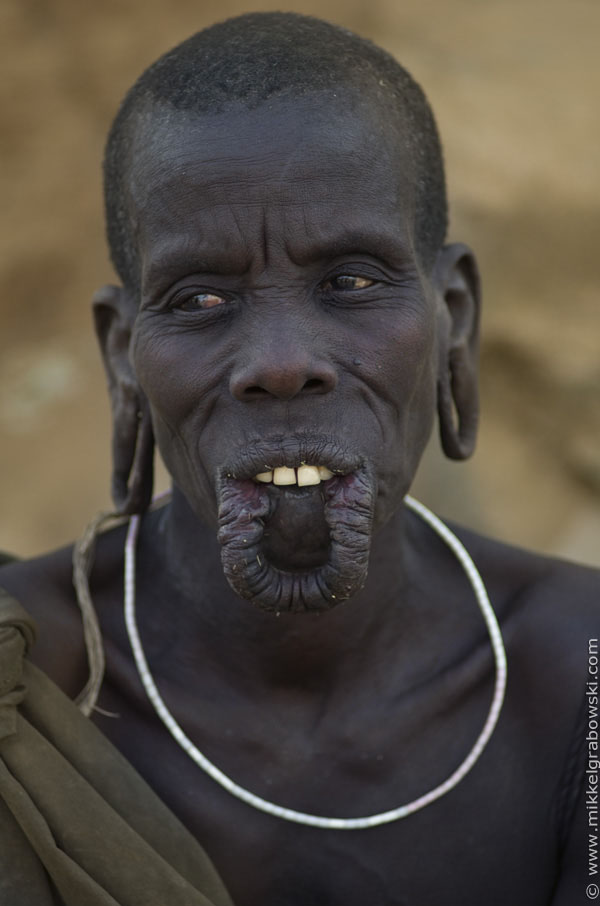 A woman from the mursi tribe without her lip plate - photo © Mikkel Grabowski