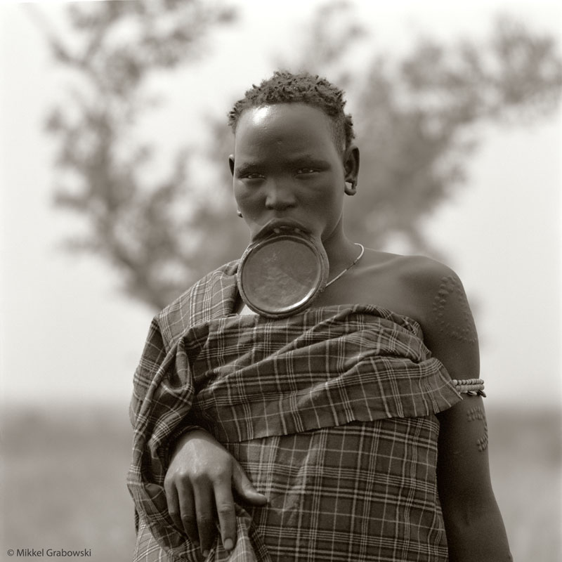 A woman from the Mursi tribe wearing the traditional lip plate - photo © Mikkel Grabowski 2012