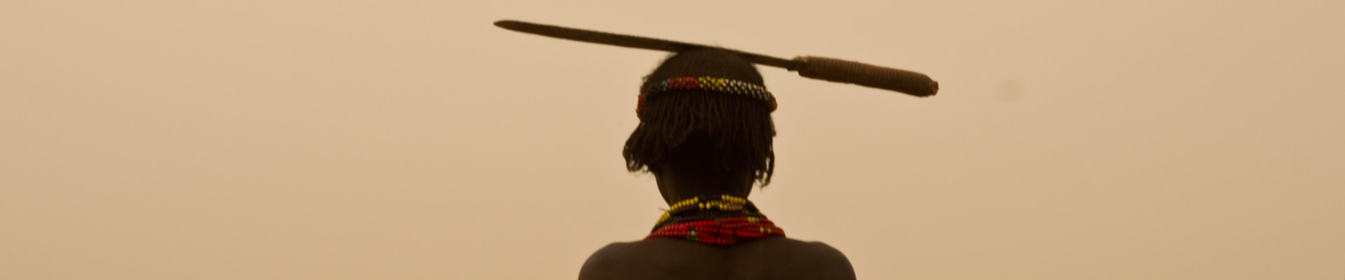 A woman in Omorate carrying a machete on her head