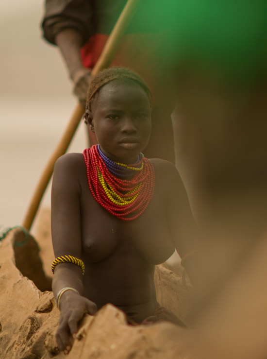 A woman in a canoe crossing the Omo River