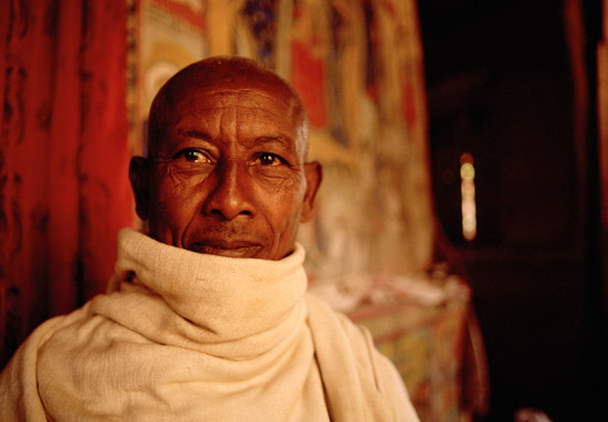 A monk in a monastery on an island in lake Tana